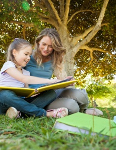 Au pair in Australia reading a book to girl